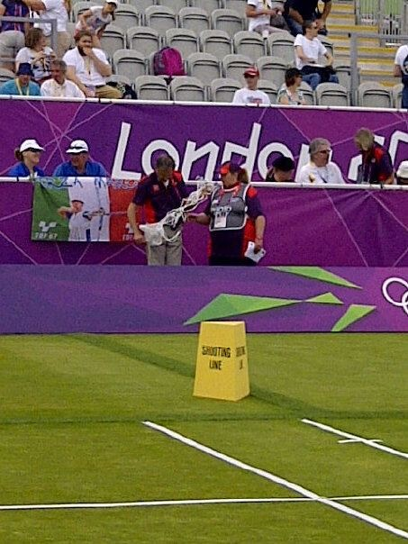 GamesMakers preparing for a medal ceremony at Lords Cricket Ground, Olympic archery competition, London 2012