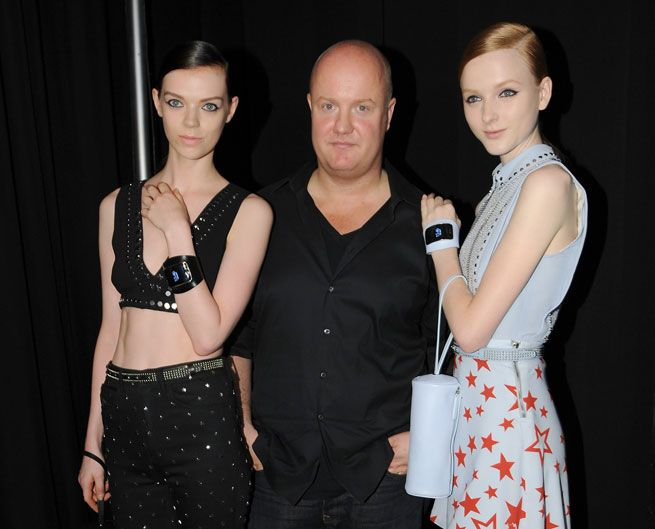 Models pose backstage with Creative Director Andreas Melbostad...