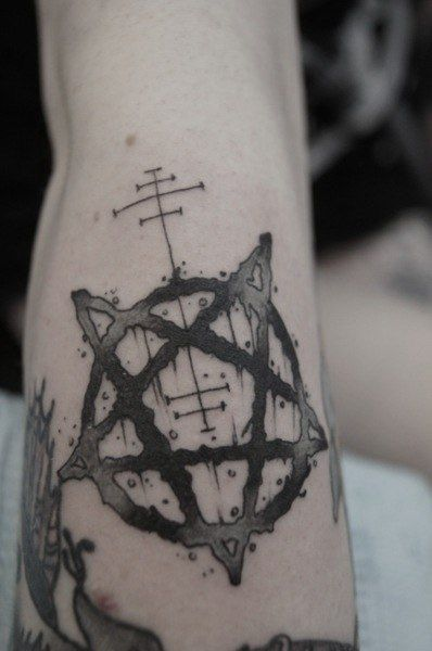 pentagram tattoo on arm