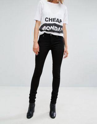 cheap monday mid rise skinny jean. asos. black.