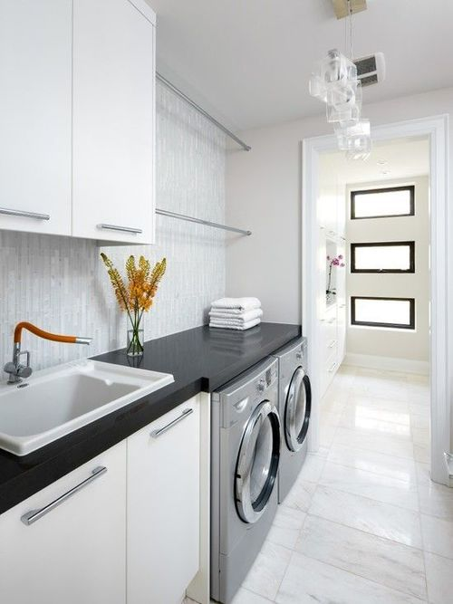 Very modern looking - like the double hanging bars over the washer/dryer, sink at W/D height.