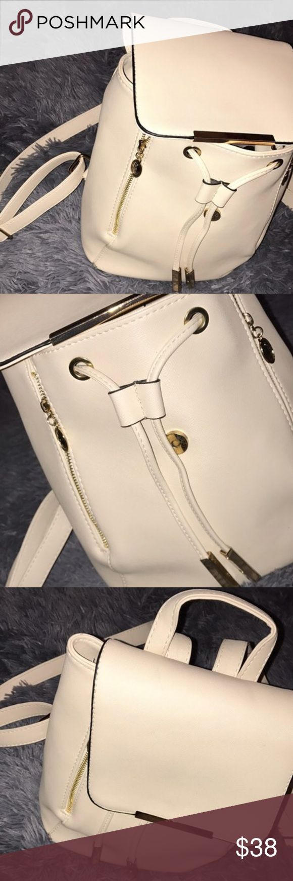 Elegant Cream Medium Backpack A gorgeous cream backpack with gold accents, big enough for books but small enough not too be too bulky! Comes with zippers to increase the size as well as plenty of pockets to keep your valuables in. Bags Backpacks