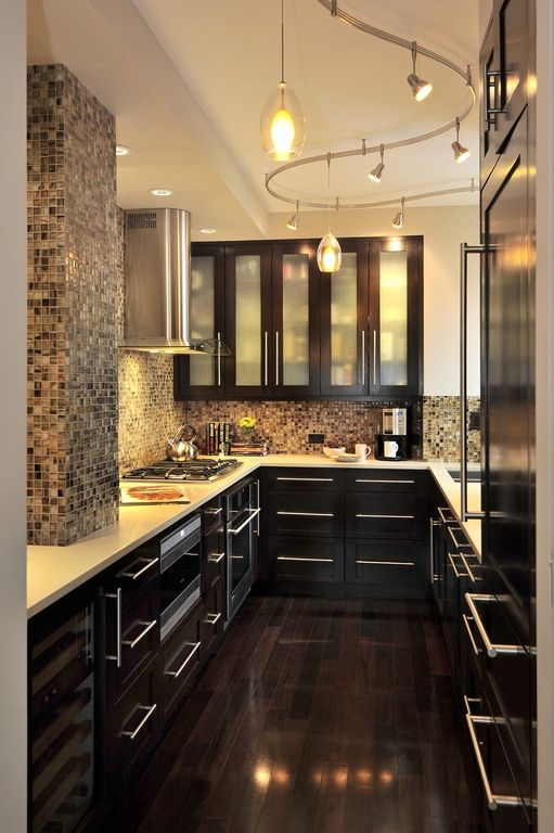 Contemporary Kitchen with Standard height, Corian counters, can lights, flush light, Alina Pendant, built-in microwave, Flush