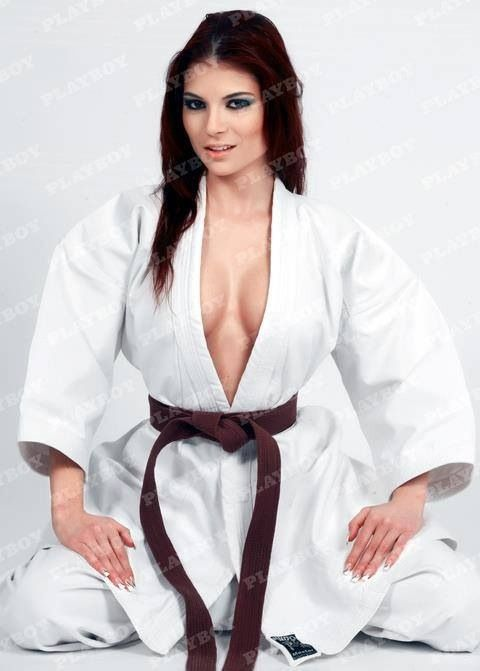 Sexy judo girl sitting on sofa stock photo