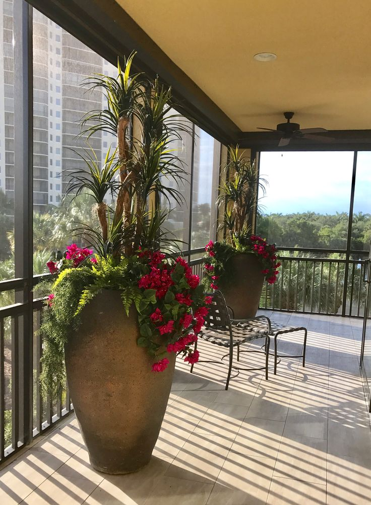 """These giant rustic containers with 60"""" outdoor artificial yucca trees inspire design options that would be impossible with real plants.  No soil, water or aggravation...just container plantings that won't lose their looks."""