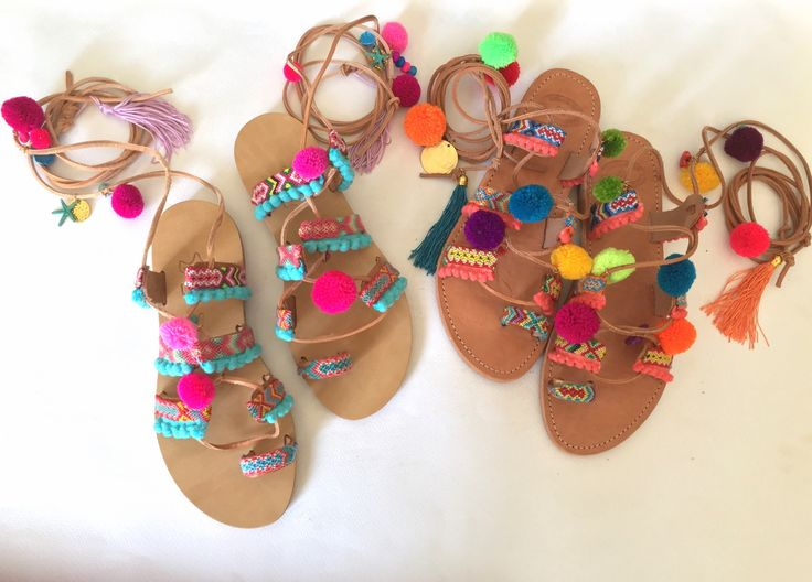 Leather Sandals with colorful friendships and pom poms.www.bohemianfootprints.etsy.com