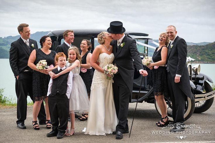 A happy bridal party cheer on the bride and groom. Check out other wedding photography by Anthony Turnham at www.snapweddingphotography.co.nz