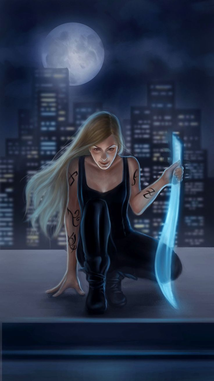 Emma Carstairs holding a seraph blade                                                                                                                                                                                 More