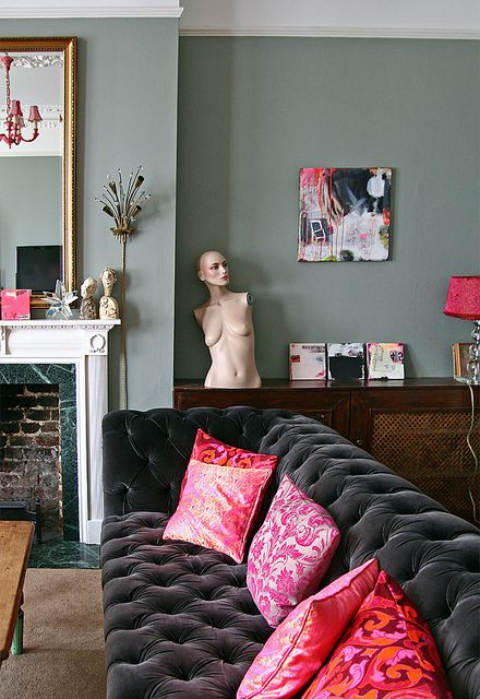 Chesterfield sofa, mannequin torso, dainty but detailed fireplace
