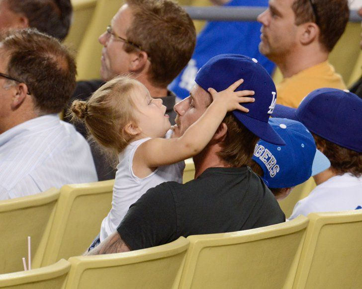 Pin for Later: David Beckham Doesn't Have a Favorite Child, but One Gets Special Treatment  Harper and David shared the sweetest daddy-daughter moment during a Dodgers game in August 2013.