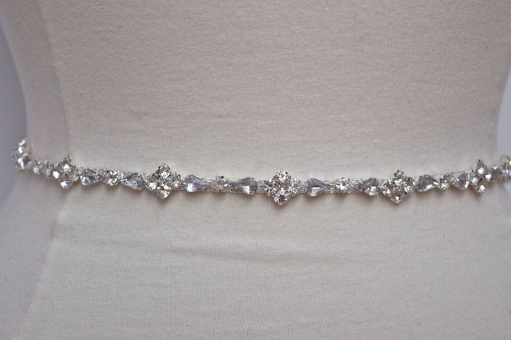 A personal favorite from my Etsy shop https://www.etsy.com/listing/221790548/thin-rhinestone-belt-bridal-belt