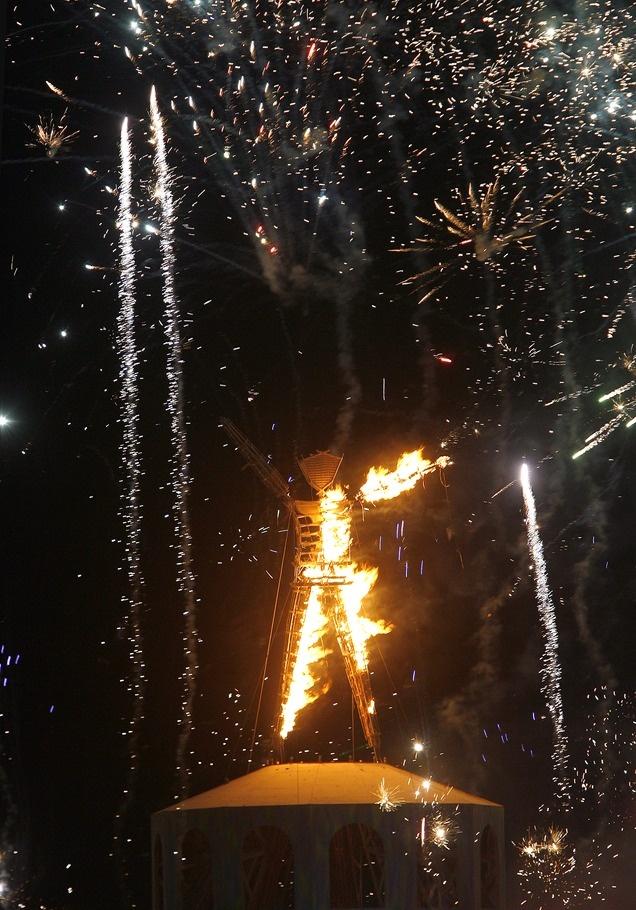 Fireworks explode as The Burning Man is set on fire Sept. 1, 2012, in Nevada's Black Rock Desert. (Rick Egan    The Salt Lake Tribune)