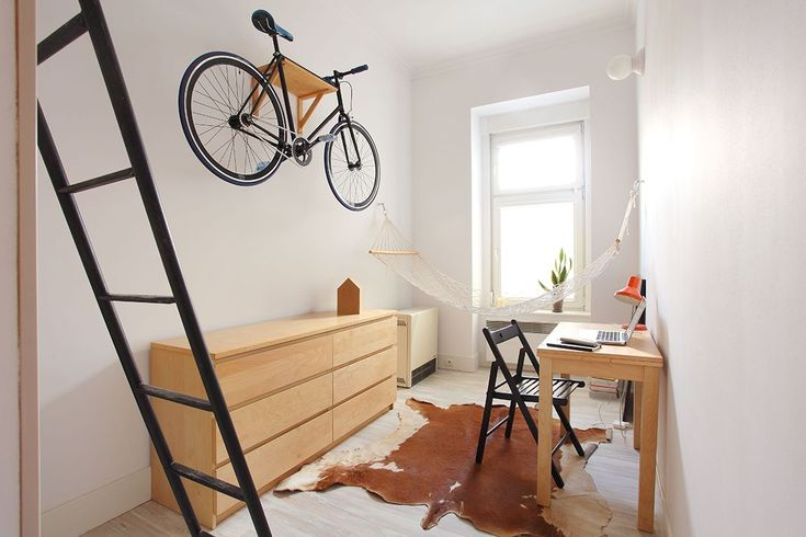 This Is The Ultimate Apartment For Single City Girls #refinery29  http://www.refinery29.com/micro-living-poland#slide-1  Although the apartment is a minuscule 140 square feet, Hanczar managed to incorporate all of the necessities of modern urban living. This includes smart storage (note the elevated bike rack) and a multifunctional desk. He even squeezed in a hammock....
