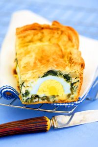 Easter Tart with Ricotta, Spinach, Egg, and cheese | A savory tart filled with springtime staples, an Easter favorite in Italy: eggs, ricotta, Parmesan, and fresh spinach enveloped in a buttery crust. @delallofoods