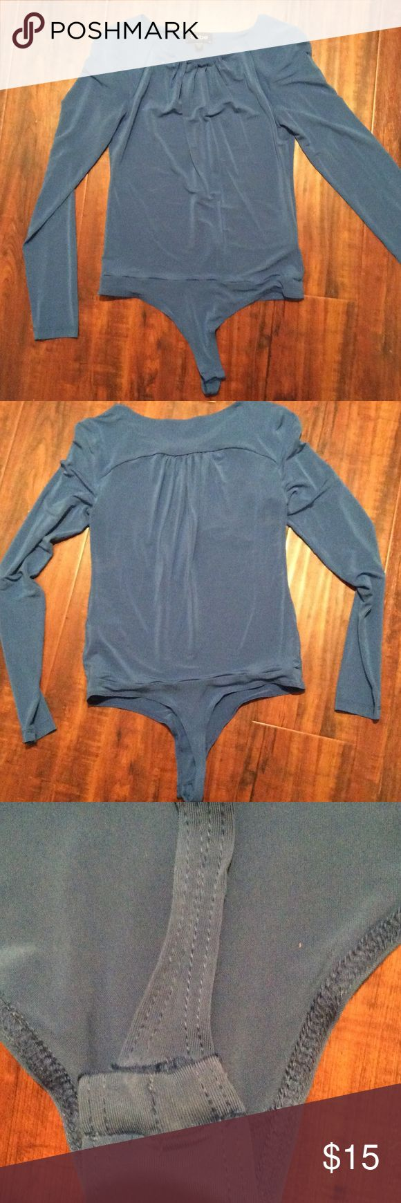 XS/S Bebe Royal Blue Bodysuit New, never worn. Snap closure thong. Royal blue color. Last pic is a good depiction of actual color. Stretchy rayon fabric. Fits like a small. bebe Tops Blouses