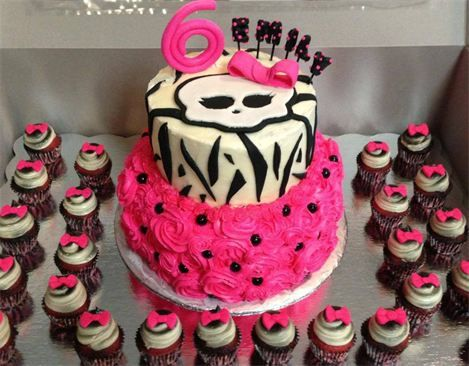 """Monster High : A custom 2-tier Monster High cake & mini cupcakes! Bottom tier is an 8"""" with buttercream rosettes. Top tier is a 6"""" all buttercream with homemade fondant accents. Number & name also edible. Mini cupcakes have homemade edible fondant bows!"""