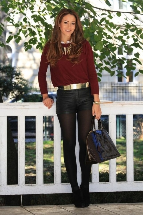 Burgundy jumper, leather shorts with tights and heels