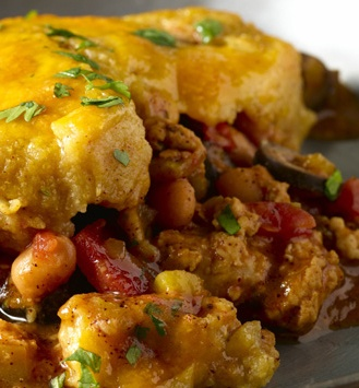 ... pinto beans, and black olives under a lush and cheesy cornmeal topping