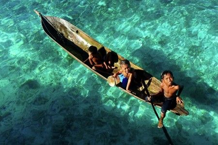 Muslianshah Bin Masrie: The sea gypsy boy with a wooden boat as a traditional and culture for them