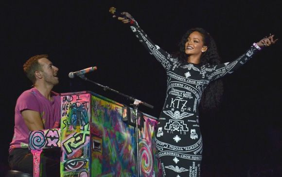"""Chris Martin of Cold Play and Rihanna perform her hit """"Umbrella"""" in Paris."""