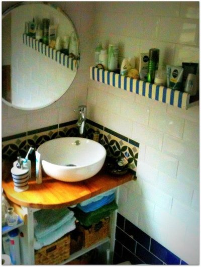 Elegant narrowboat bathroom with Metro tiles and contemporary countertop sink