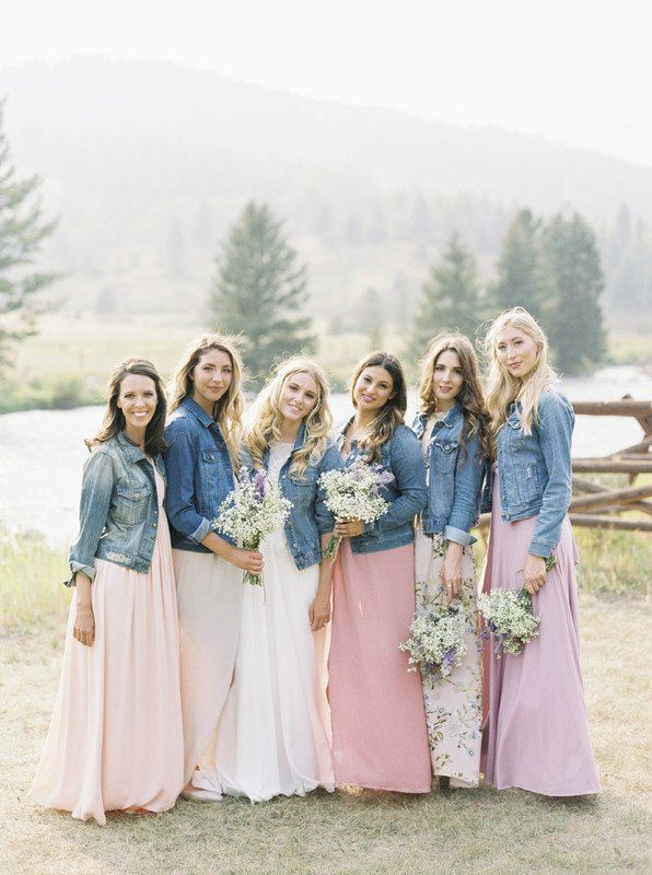 e7b002063e0 8 Unexpected Fall Wedding Trends for 2018 - bride and bridesmaids wearing  denim jackets  Emily Blumberg Photography