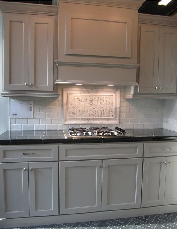 gray cabinets; black counters; slate herringbone floor; marble hex backsplash accent absolutely gorgeous!!