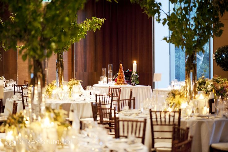 Tiffany chairs, tree branch center pieces, fresh leafy foliage, aromatic candles, a croquembouche wedding cake... it couldn't be more magical. Amazing wedding reception styling, ideas and inspiration.  Reception Venue: UWA Club  Photography by DeRay & Simcoe
