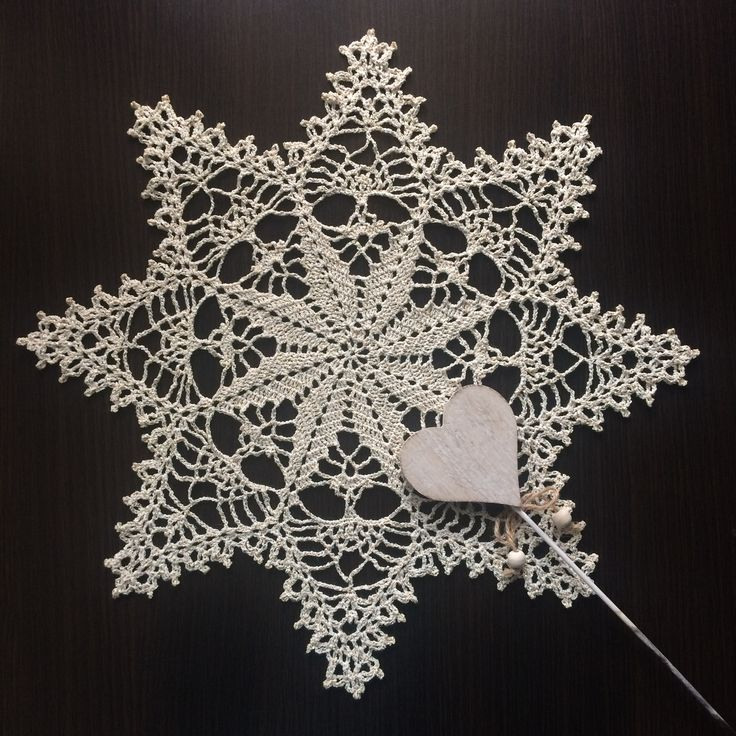 Handmade crochet doily with star pattern and golden-beige color