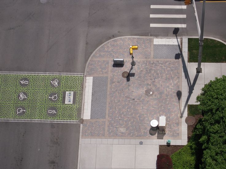 The pedestrian plaza, accented with Hanover Pavers, serves as a refuge for cyclist and pedestrians as they wait to cross streets. Indianapolis Cultural Trail | Indianapolis, Indiana, USA | Landscape Architect: Rundell Ernstberger Associates | Learn more at: reasite.com