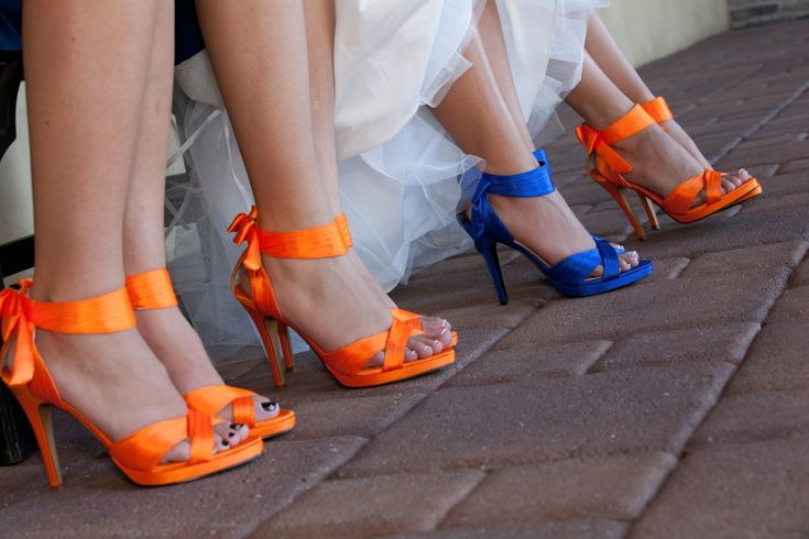 The bride's shoes were blue and her bridesmaid's orange in this dramatic fall wedding at TPC Valencia. maybe not orange but you get the idea