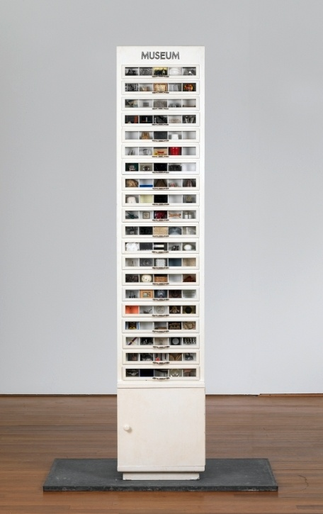 1970-77 is the title of Herbert Distel's work. It consists of a found cabinet (a haberdashery's cabinet for reels of sewing silk) with 25 drawers, each containing 25 'rooms', to which he invited living artists to produce a miniature work of art. The rooms of the museum were completely filled over the years 1970-77. It is in the collection of the Kunsthaus Zürich/Switzerland.