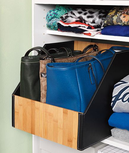 Purses organized in closet bin Bags should sit, not hang—hanging can leave straps misshapen. File purses neatly in a low-front bin that makes it quick to find favorites. Real Simple Magazine