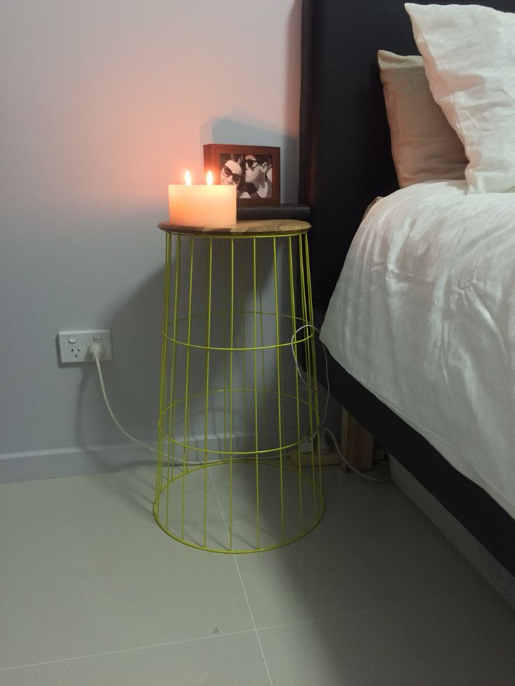 Kmart hack bedside table | 1x wire laundry basket + 1x round wooden chopping board $20 total.