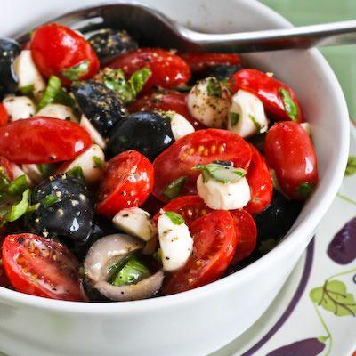 Tomato, Olive, and Mozzarella Salad with Basil Vinaigrette By Kalyn Denny