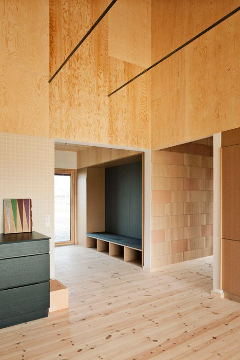 Raw plywood was used to create a maintenance-free interior for this house in Denmark.