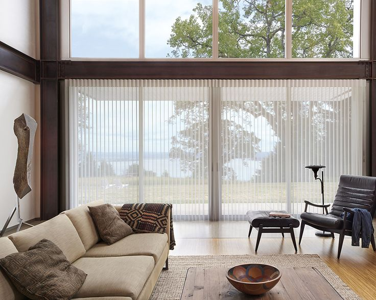 A contemporary neutral palette and enlarged windows uplift this room with the light filtering style of Luminette® Privacy Sheers. ♦ Hunter Douglas window treatments #LivingRoom