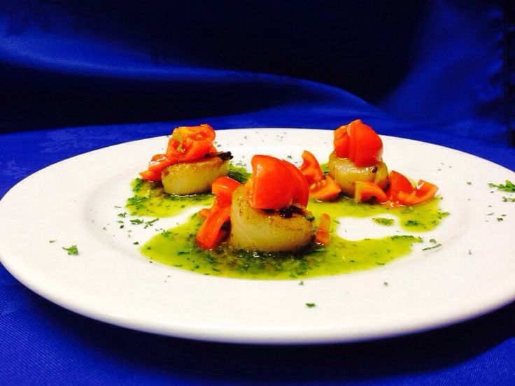 Capesante al Forno- sautéed scallops, then oven backed, served with Sicilian cherry tomatoes on pinzimonio sauce, finished with olive oil and parsley