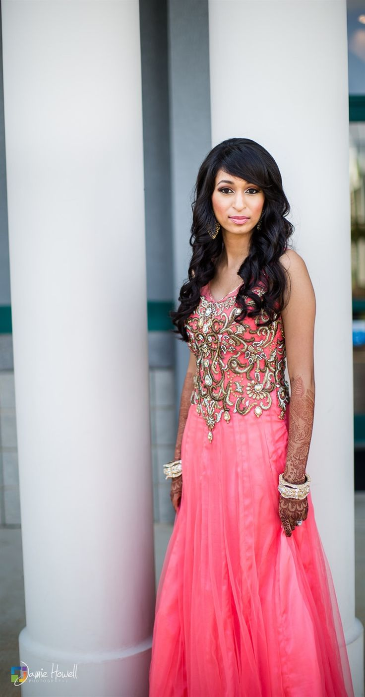 Stunning coral fusion bridal dress- accented with soft, wavy curls and beautiful henna-adorned hands! #hindubride #indianbrides photo courtesy Jamie Howell Photography