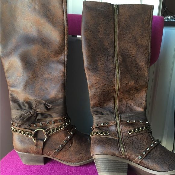 New in box not rated boots from buckle Very cute size 9.5. We're just one size too small for me super cute. Similar to naughty monkey brand Not Rated Shoes Heeled Boots