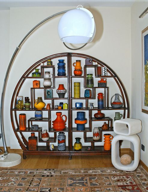 The ultimate display shelf for pottery of any type but especially this exceptional group of West German pottery.