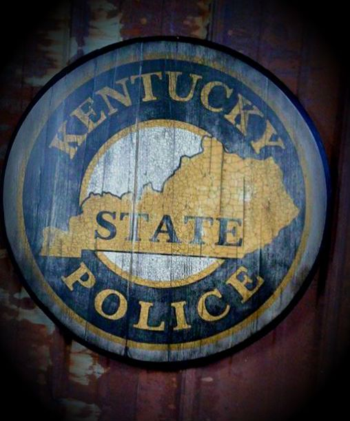 Hand painted Kentucky State Police Logo. Created on a true used bourbon barrel top. For this and many other designs, check out shop.mattinglysignart.com