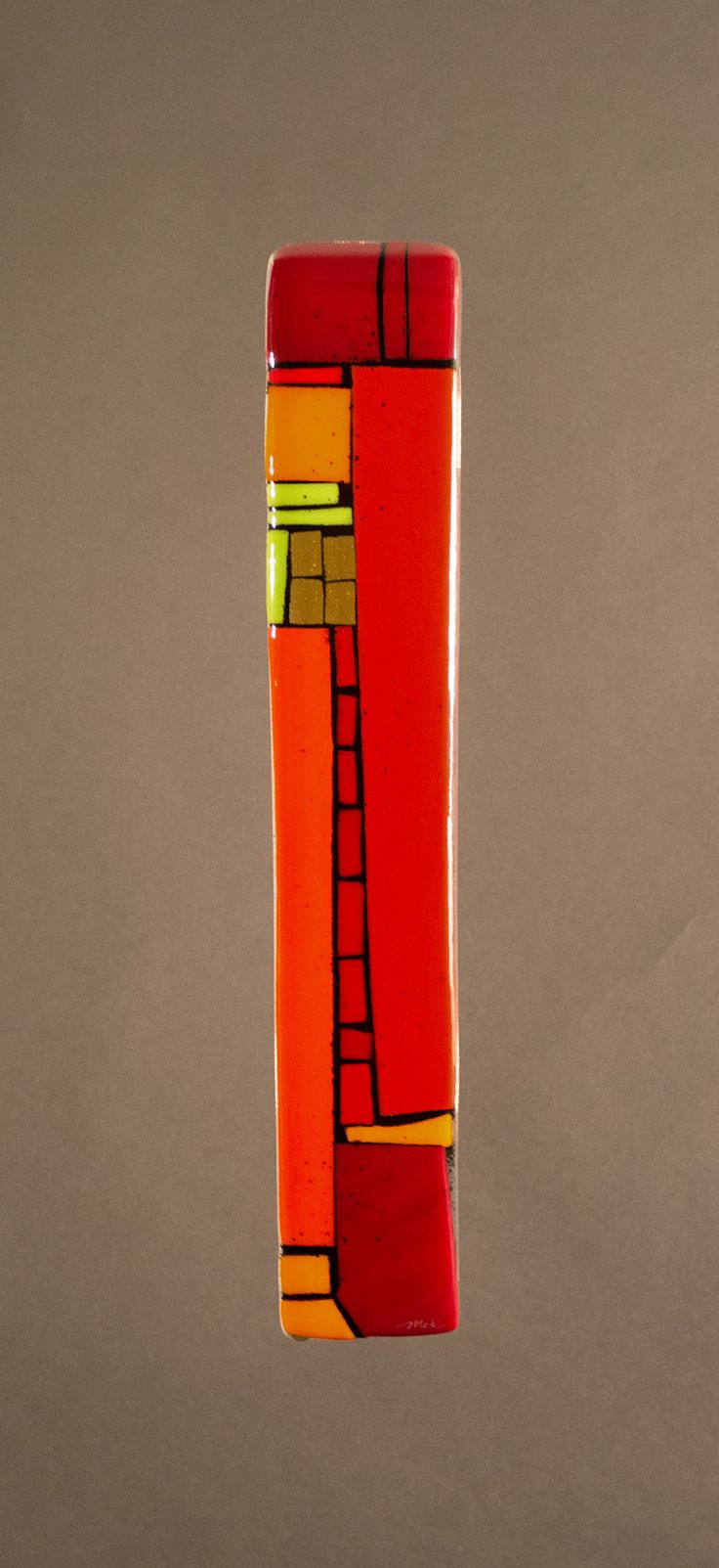 House Party Red II by Vicky Kokolski and Meg Branzetti. Pump up the volume; it is time for a party. Created by cutting vibrant red and accented orange and green art glass. Outlined with powdered frit to achieve the desired effect. Hung with picture frame wire in the back.