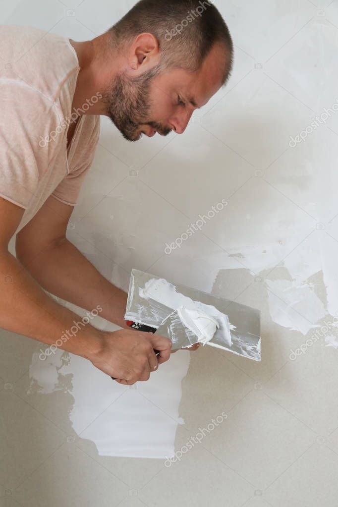 Man Plastering Wall Putty Knife Fixing Wall Surface Preparation Painting Plaster Wall Putty Knives