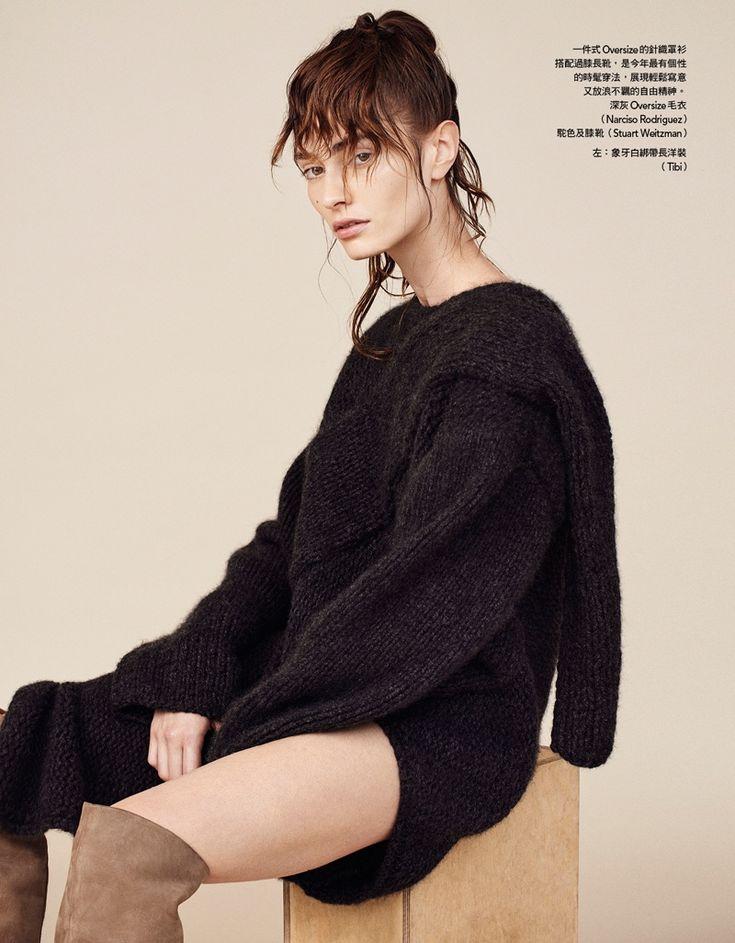 Marine Deleeuw models Narciso Rodriguez oversized sweater with Stuart Weitzman over-the-knee boots