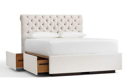 Chesterfield Upholstered Headboard & Storage Platform Bed at Pottery Barn, $999 (headboard) + $1,529 (special, bed)/queen.