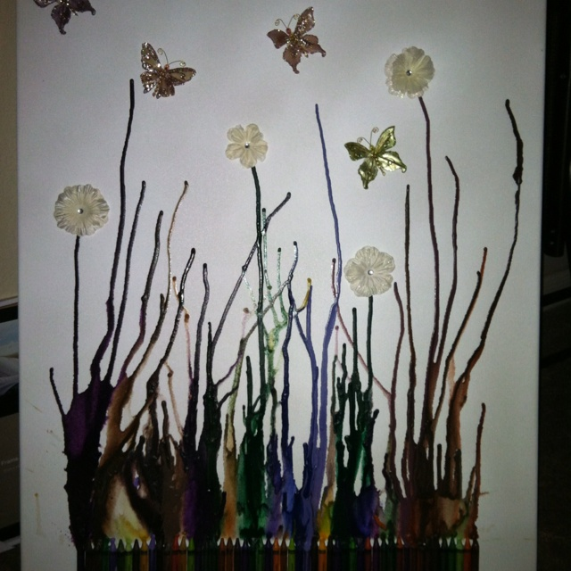 Glued crayons to the bottom of the canvas and used my hair dryer to melt them and then glued the Daisy's and butterflies. Love this! Simple. Easy. & quick!!!!