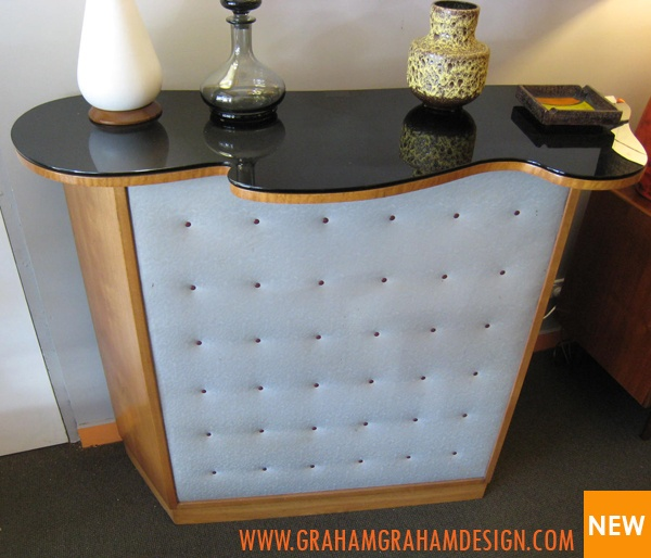 Soooo Mad Men bar with storage for all your drinks behind. Drinks anyone?