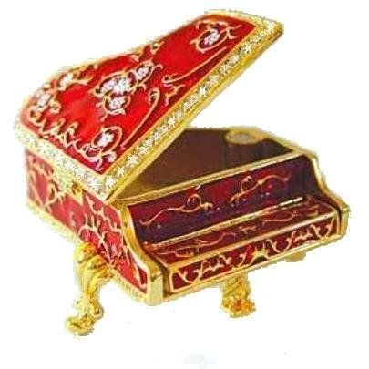 Red Grand Piano Box Swarovski Crystals 24K Gold Jewelry, Trinket or Pill Box Figurine Dazzlers. $34.95. Certificate of Authenticity included. Limited edition item which is sure to grow in value over time.. Detailed in 24 karat gold and set with sparkling Swarovski Crystals and meticulously hand enameled by skilled artisans.. This miniature, three inch Piano Box opens to reveal a storage compartment that's been completely finished in a swirled, iridescent enamel.  The floral desig...