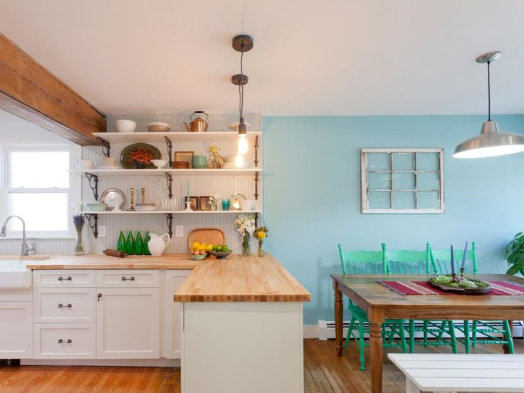 beadboard walls butcher block countertops and farmhouse table maintain a cottage feel long shelves metal accents